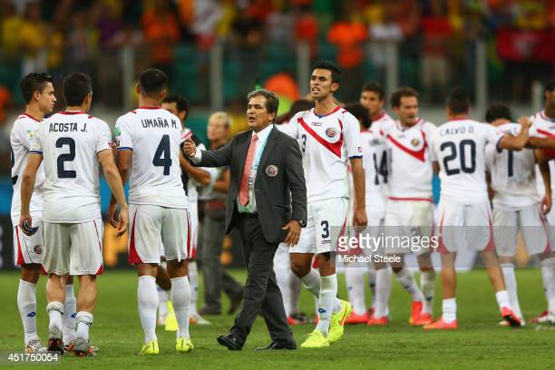 Head coach Jorge Luis Pinto of Costa Rica consoles his players after a defeat to the Netherlands in a penalty shootout during the 2014 FIFA World Cup...