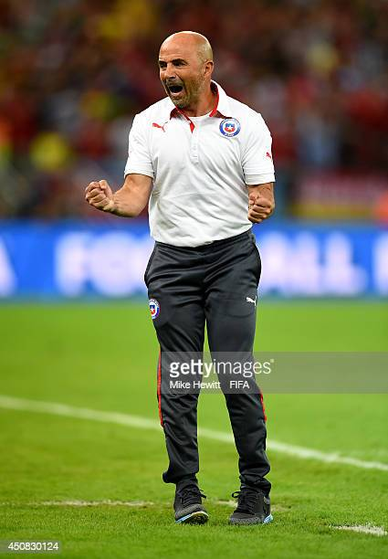 Head coach Jorge Sampaoli of Chile celebrates the 20 win after the 2014 FIFA World Cup Brazil Group B match between Spain and Chile at Estadio...