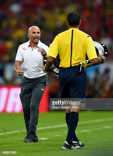 Head coach Jorge Sampaoli of Chile speaks to fourh official Nawaf Shukralla during the 2014 FIFA World Cup Brazil Group B match between Spain and...