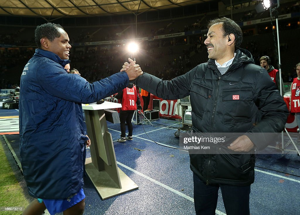Head coach Jos Luhukay (R) of Berlin and Ronny (L) show their delight after winning the Second Bundesliga match between Hertha BSC Berlin and Eintracht Braunschweig at Olympic stadium on April 8, 2013 in Berlin, Germany.