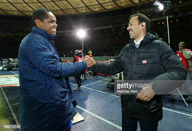 Head coach Jos Luhukay of Berlin and Ronny show their delight after winning the Second Bundesliga match between Hertha BSC Berlin and Eintracht...