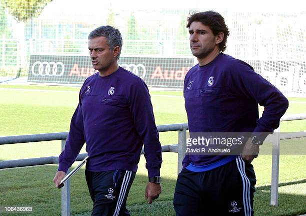 Head coach Jose Mourinho and assistant coach Aitor Karanka of Real Madrid walk onto the pitch before the training session at the Valdebebas training...