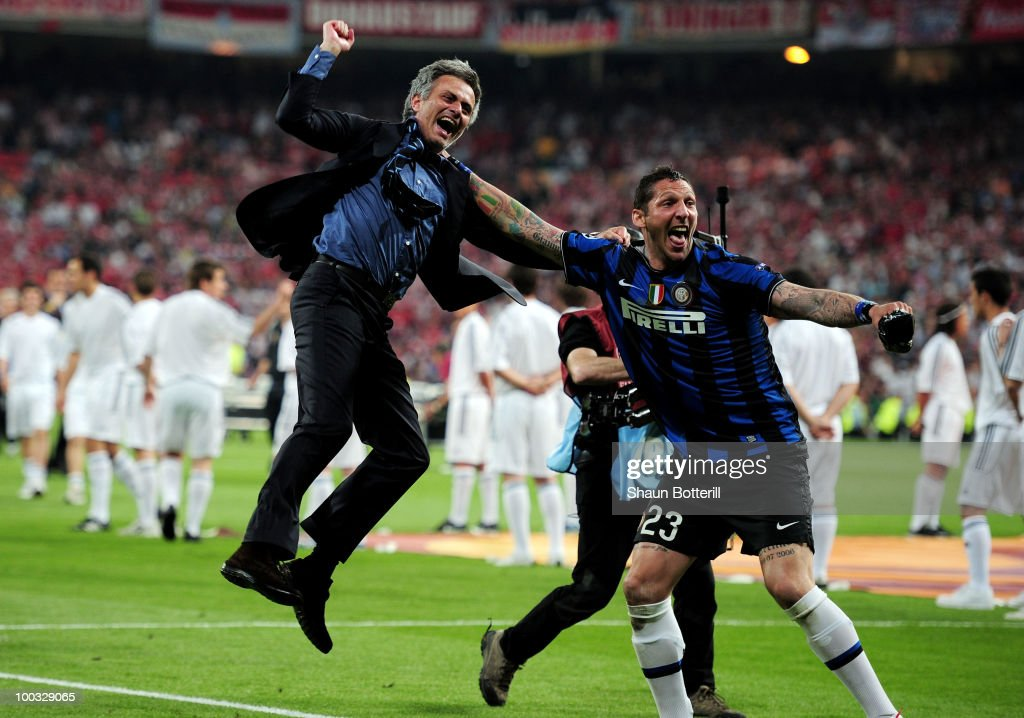 Head coach Jose Mourinho (L) and Marco Materazzi of Inter Milan celebrate their team's victory at the end of the UEFA Champions League Final match between FC Bayern Muenchen and Inter Milan at the Estadio Santiago Bernabeu on May 22, 2010 in Madrid, Spain.