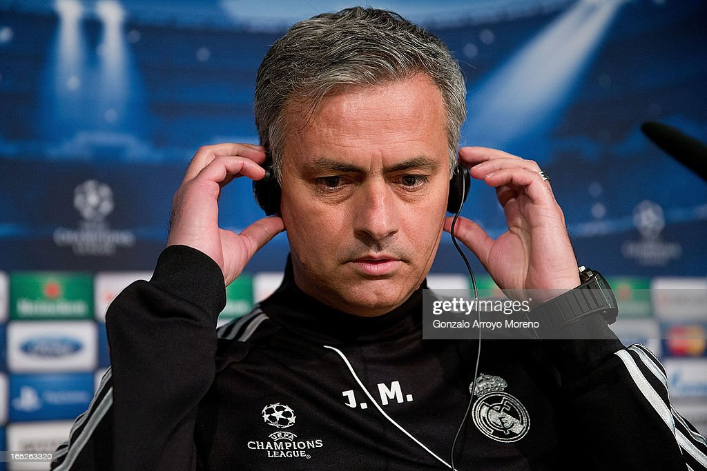Head coach Jose Mourinho buts his headphones in order to listen to questions from the media during a press conference ahead of the UEFA Champions League Quarterfinal match between Real Madrid and Galatasaray AS at Santiago Bernabeu Stadium on April 2, 2013 in Madrid, Spain.