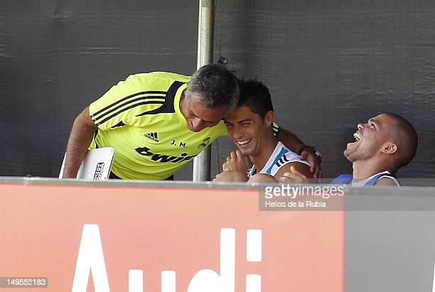 Head coach Jose Mourinho jokes with Cristiano Ronaldo and Pepe of Real Madrid during a training session at UCLA Campus on July 30 2012 in Los Angeles...