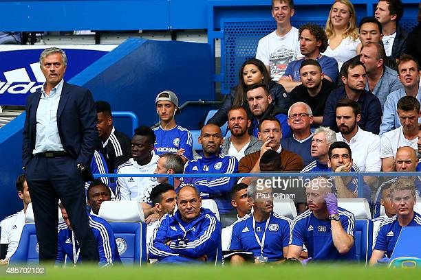 Head coach Jose Mourinho of Chelsea stands in front of the bench while John Terry of Chelsea watches from the stand during the Barclays Premier...