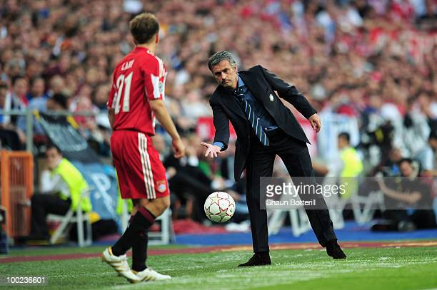 Head coach Jose Mourinho of Inter Milan throws the ball to Philipp Lahm of Bayern Muenchen during the UEFA Champions League Final match between FC...