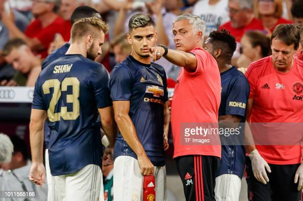 Head coach Jose Mourinho of Manchester United speaks with Andreas Pereira of Manchester United during the friendly match between Bayern Muenchen and...