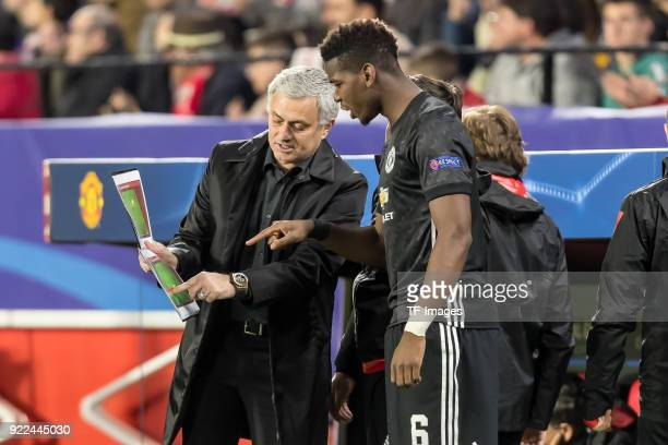 Head coach Jose Mourinho of Manchester United speaks with Paul Pogba of Manchester United during the UEFA Champions League Round of 16 First Leg...