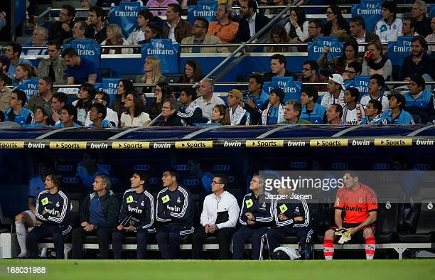 Head coach Jose Mourinho of Real Madrid and now reserve goalkeeper Iker Casillas sit on the bench towards the end of the la Liga match between Real...