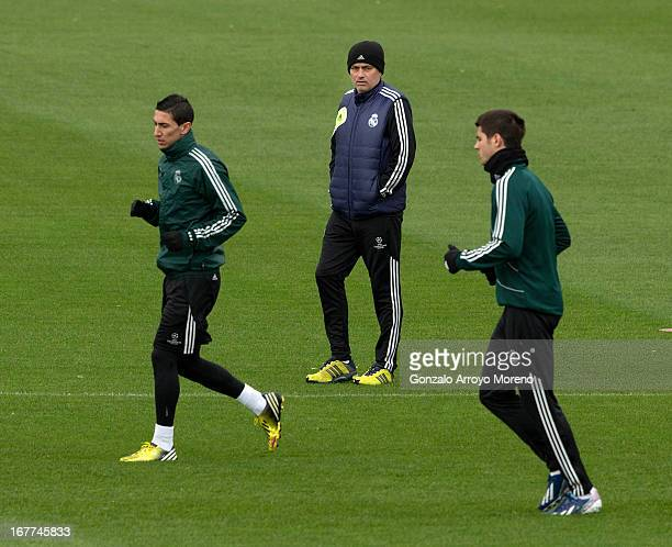 Head coach Jose Mourinho of Real Madrid CF watches Angel Di Maria and Alvaro B Morata during a training session ahead of the UEFA Champions League...