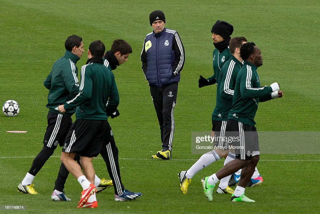 Head coach Jose Mourinho of Real Madrid CF watches his players during a training session ahead of the UEFA Champions League Semifinal second leg match between Real Madrid and Borussia Dortmund at the Valdebebas training ground on April 29, 2013 in Madrid, Spain.