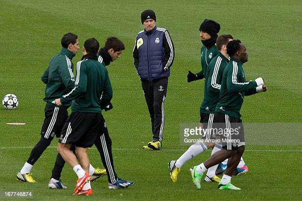 Head coach Jose Mourinho of Real Madrid CF watches his players during a training session ahead of the UEFA Champions League Semifinal second leg...