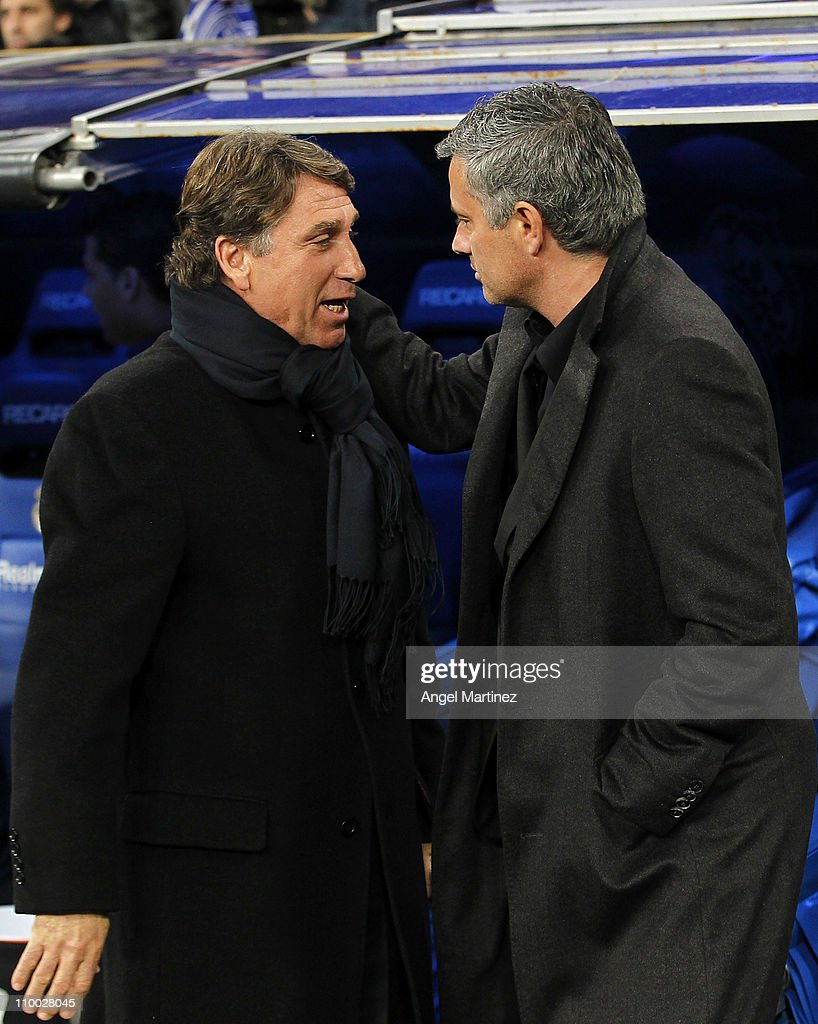 Head coach Jose Mourinho (R) of Real Madrid chats with head coach Esteban Vigo of Hercules before the La Liga match between Real Madrid and Hercules at Estadio Santiago Bernabeu on March 12, 2011 in Madrid, Spain.