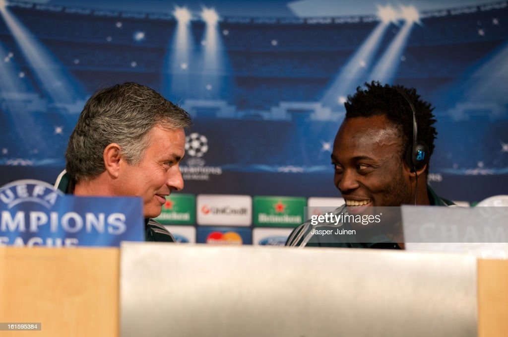 Head coach Jose Mourinho (L) of Real Madrid chats with his player Michael Essien during a press conference ahead of the UEFA Champions League match between Real Madrid CF and Manchester United at the Valdebebas training ground on February 12, 2013 in Madrid, Spain.