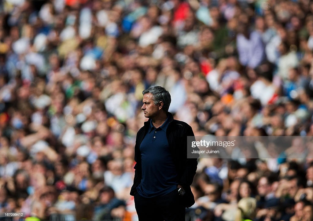 Head coach Jose Mourinho of Real Madrid follows the game during the la Liga match between Real Madrid CF and Real Betis Balompie at Estadio Santiago Bernabeu on April 20, 2013 in Madrid, Spain.