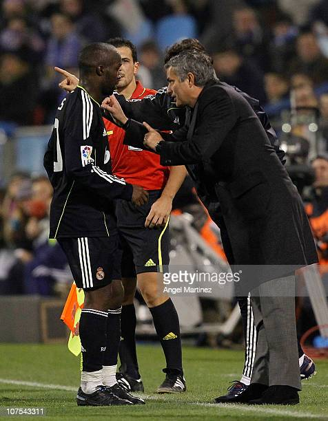 Head coach Jose Mourinho of Real Madrid gives instructions to Lass Diarra during the La Liga match between Real Zaragoza and Real Madrid at La...