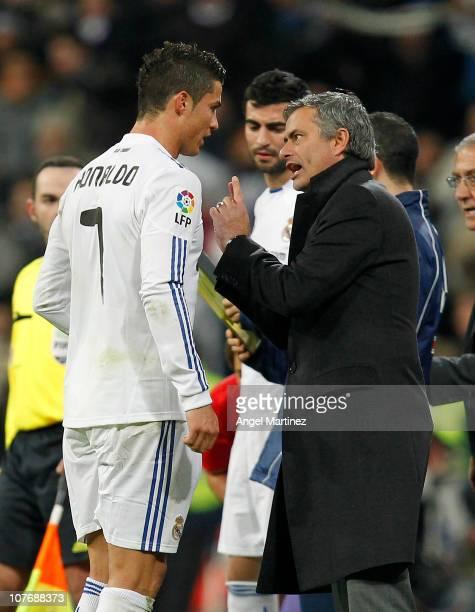 Head coach Jose Mourinho of Real Madrid gives instructions to Cristiano Ronaldo during the La Liga match between Real Madrid and Sevilla at Estadio...