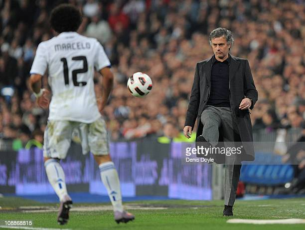 Head coach Jose Mourinho of Real Madrid kicks the ball back during the La Liga match between Real Madrid and Real Sociedad at Estadio Santiago...