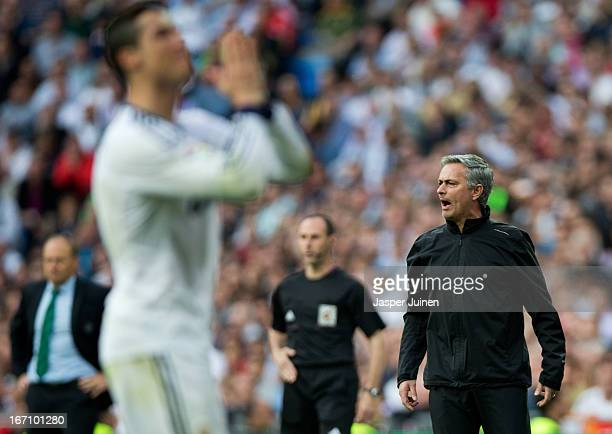 Head coach Jose Mourinho of Real Madrid reacts as Cristiano Ronaldo gestures during the la Liga match between Real Madrid CF and Real Betis Balompie...