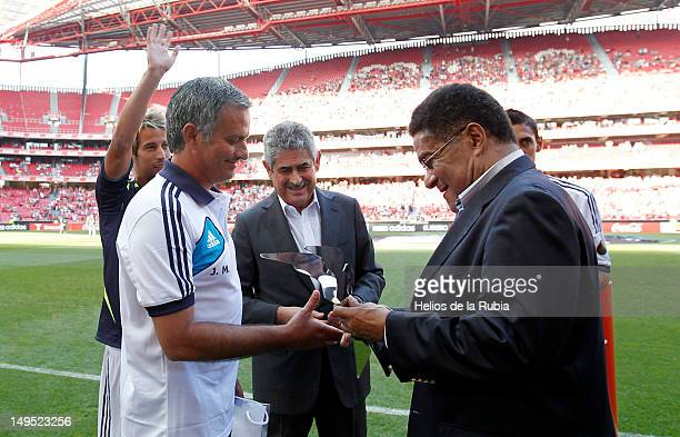 Head coach Jose Mourinho of Real Madrid receives a gift from football legend Eusebio before the Eusebio Cup match between Benfica and Real Madrid at...