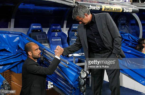 Head coach Jose Mourinho of Real Madrid shakes hands with head coach Jose Guardiola of Barcelona prior of the La Liga match between Real Madrid and...