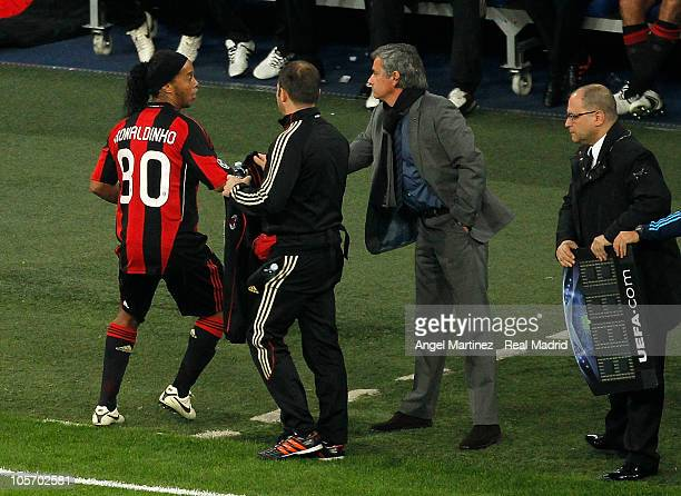 Head coach Jose Mourinho of Real Madrid shakes hands with Ronaldinho of AC Milan during the Champions League group G match between Real Madrid and AC...