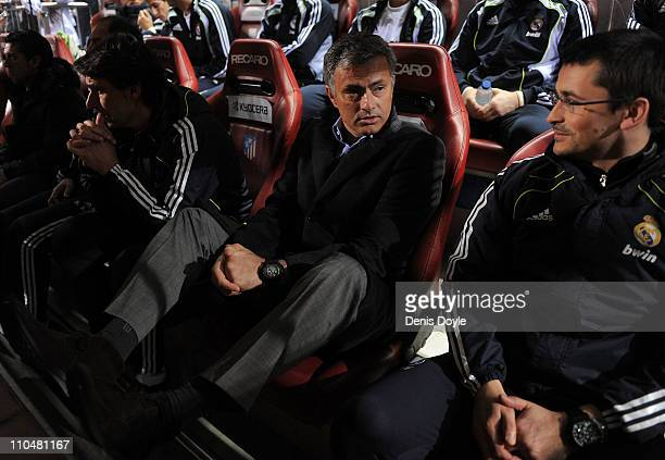 Head coach Jose Mourinho of Real Madrid sits in the substitutes bench at the start of the La Liga match between Atletico Madrid and Real Madrid at...