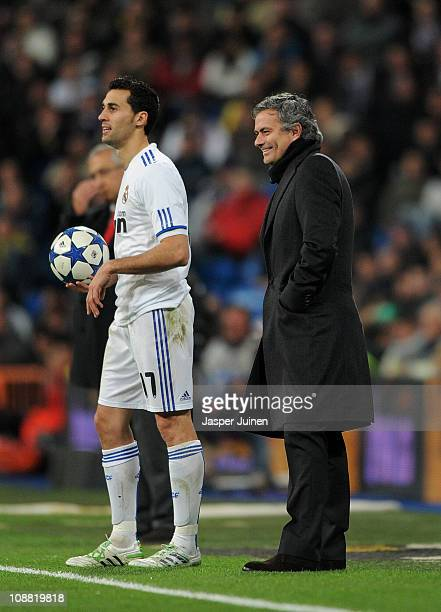 Head coach Jose Mourinho of Real Madrid smiles as he stands by Alvaro Arbeloa of Real Madrid during the semi-final Copa del Rey second leg match...