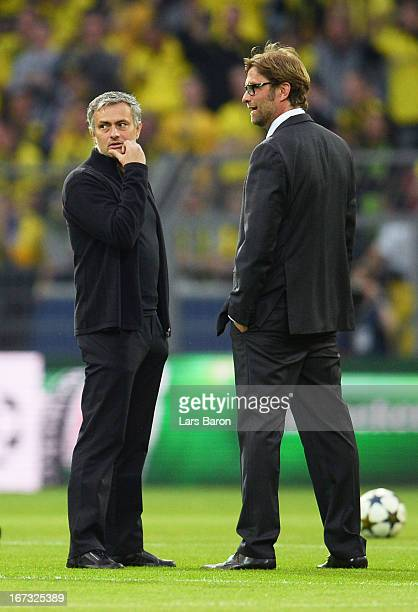 head coach Jose Mourinho of Real Madrid speaks to Head Coach Jurgen Klopp of Borussia Dortmund ahead of the UEFA Champions League semi final first...