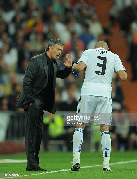 Head coach Jose Mourinho of Real Madrid talks to Pepe of Real Madrid during the La Liga match between Real Madrid and Barcelona at Estadio Santiago...