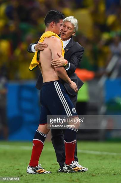 Head coach Jose Pekerman of Colombia consoles James Rodriguez after being defeated by Brazil 21 during the 2014 FIFA World Cup Brazil Quarter Final...