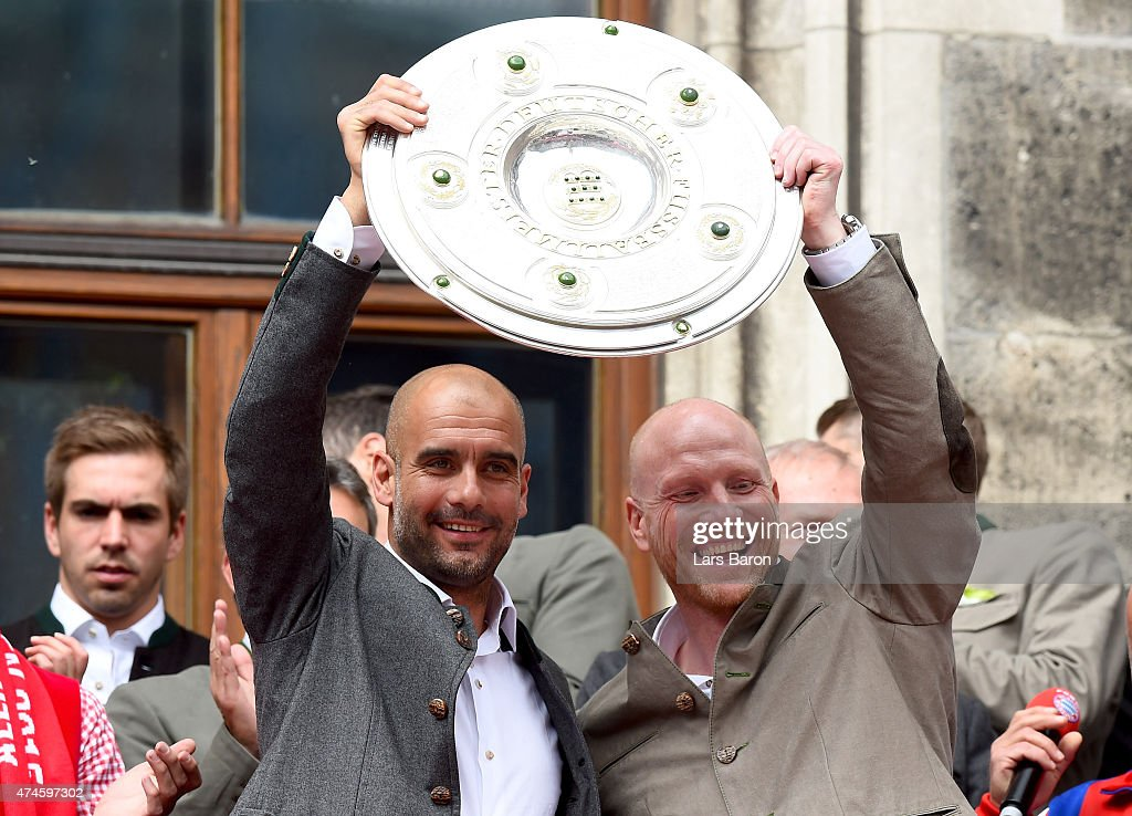 Head coach Josep Guardiola and manager Matthias Sammer lift the trophy and celebrate winning the Bundesliga at Marienplatz on May 24, 2015 in Munich, Germany.