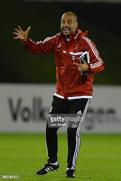 Head coach Josep Guardiola gestures during a training session at day 3 of the Bayern Muenchen training camp at ASPIRE Academy for Sports Excellence...