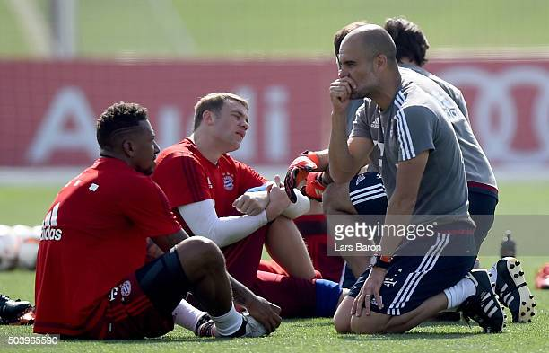 Head coach Josep Guardiola gives instructions to Jerome Boateng during a training session at day three of the Bayern Muenchen training camp at Aspire...