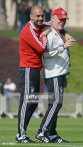 Head coach Josep Guardiola jokes with assistant coach Hermann Gerland during a training session at day 5 of the Bayern Muenchen training camp at...