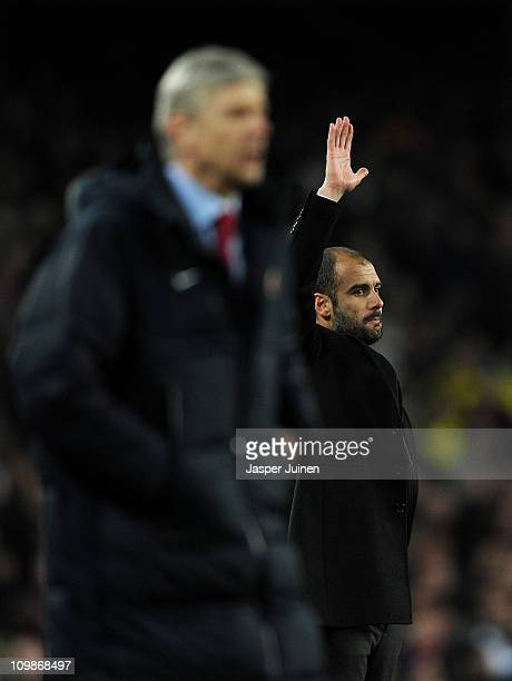 Head coach Josep Guardiola of Barcelona reacts besides head coach Arsene Wenger of Arsenal during the UEFA Champions League round of 16 second leg...