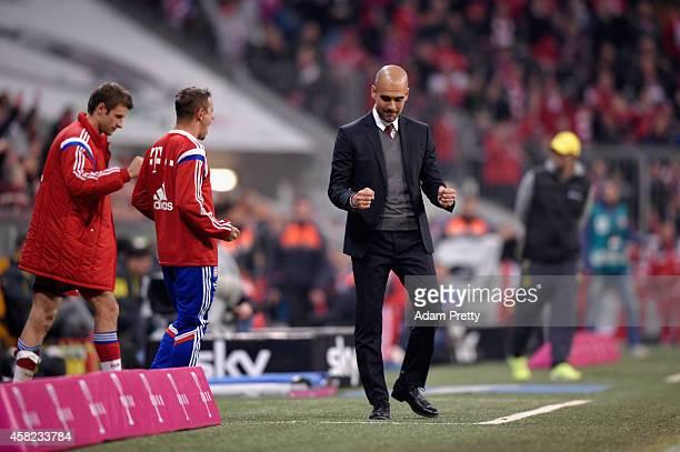 Head Coach Josep Guardiola of Bayern Muenchen celebrates victory during the Bundesliga match between FC Bayern Muenchen and Borussia Dortmund at...