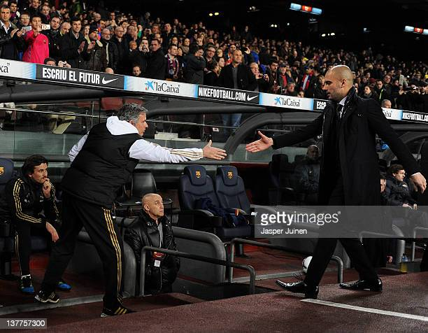 Head coach Josep Guardiola of FC Barcelona greets head coach Jose Mourinho of Real Madrid during the Copa del Rey quarter final second leg match...