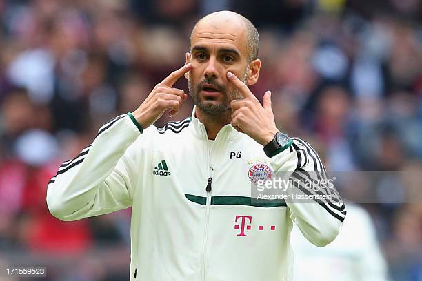 Head coach Josep Guardiola of FC Bayern Muenchen gestures during a training session at Allianz Arena on June 26 2013 in Munich Germany
