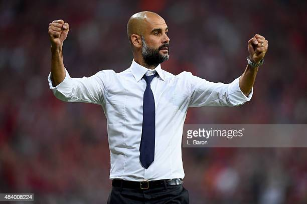 Head coach Josep Guardiola of Muenchen celebrates after Robert Lewandowski scored the second goal during the Bundesliga match between FC Bayern...