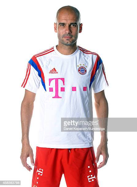 Head Coach Josep Guardiola poses during the FC Bayern Muenchen Team Presentation for DFL on August 9 2014 in Munich Germany
