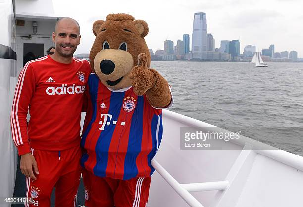 Head coach Josep Guardiola poses with mascot Berni for a picture during a boat trip on day three of the Audi Summer Tour USA 2014 at Montclair...