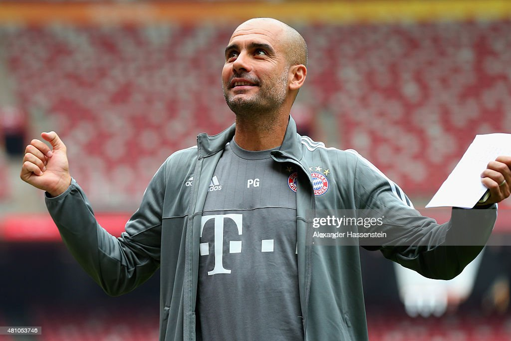 Head coach Josep Guardiola reacts during a FC Bayern Muenchen training session at National Stadium at day 1 of the FC Bayern Audi China Summer Pre-Season Tour on July 17, 2015 in Beijing, China.
