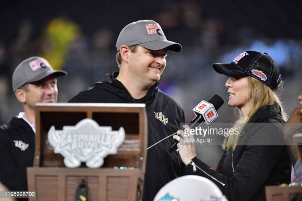 Head coach Josh Heupel of the UCF Knights gets interviewed after defeating the Marshall Thundering Herd 4825 at the Bad Boy Mowers Gasparilla Bowl at...