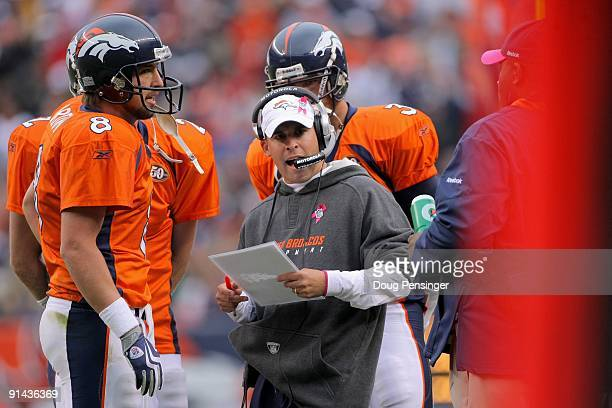 Head coach Josh McDaniels of the Denver Broncos along with quarterback Kyle Orton leads his team against the Dallas Cowboys during NFL action at...
