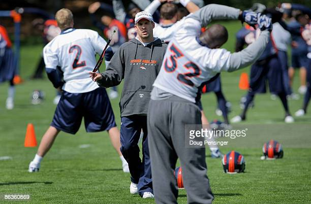 Head coach Josh McDaniels of the Denver Broncos chats with running back LaMont Jordan during minicamp at the Broncos training facility on May 3 2009...