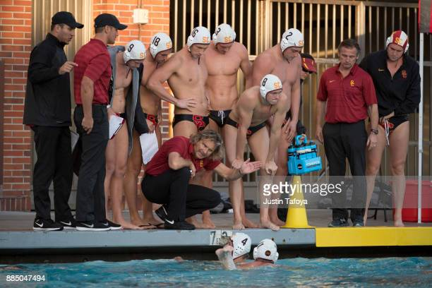 Head coach Jovan Vavic of the University of Southern California instructs his team during the Division I Men's Water Polo Championship held at the...