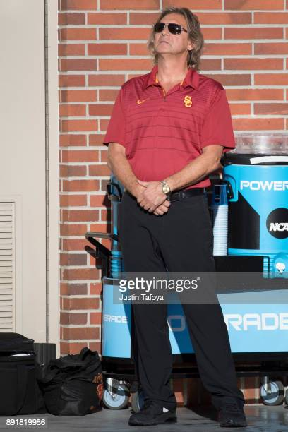 Head coach Jovan Vavic of USC stands for the National Anthem during the Division I Men's Water Polo Championship held at the Uytengsu Aquatics Center...