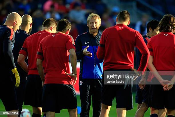 Head coach Jürgen Klinsmann talks with players during a training session for the US Men's National Soccer Team in advance of their game vs Jamaica at...